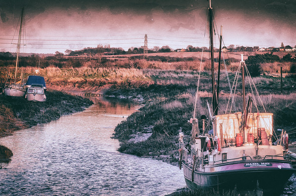 The Hazel May aground with the tide out on a bleak winter's evening
