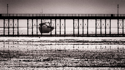 view of fishing boat underneath Southend Pier